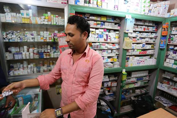 Pharmacist Abul Hamid discovered the human trafficking around his small shop when a young man raced in, bleeding from wounds and begged for help.