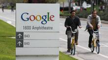 Google workers ride bikes outside of company headquarters in Mountain View, Calif., April 12, 2012. (Paul Sakuma/AP/Paul Sakuma/AP)