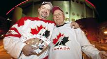 Jermey Vander Maaten and his 86-year-old grandfather Herbert Cross show some of their tickets for the world junior tournament. Vander Maaten paid more than $3000 for tickets to all the games that take place in Calgary. (Chris Bolin for The Globe and Mail/Chris Bolin for The Globe and Mail)