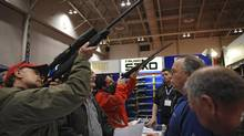 Gun enthusiasts at the Toronto Sportsmen's Show at the Direct Energy Centre in at Exhibition Place in Toronto, Ont. March 20, 2009. (Kevin Van Paassen/THE GLOBE AND MAIL)
