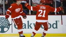 Detroit Red Wings forward Gustav Nyquist, left, receives congratulations from left wing Tomas Tatar after scoring in the first period against the Minnesota Wild at Joe Louis Arena (Rick Osentoski/USA Today Sports)
