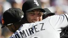 Chicago White Sox starting pitcher Phil Humber, center, is mobbed by teammates after pitching a perfect baseball game against the Seattle Mariners, Saturday, April 21, 2012, in Seattle. The White Sox won 4-0. (AP Photo/Elaine Thompson) (Elaine Thompson)
