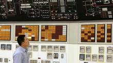 A worker checks the control panel of the No.1 unit of Qinshan No. 2 Nuclear Power Plant, China's first self-designed and self-built national commercial nuclear power plant in this June 10, 2005, file photo, in Qinshan, about 125 kilometers (about 90 miles) southwest of Shanghai, China. (Eugene Hoshiko/The Canadian Press)