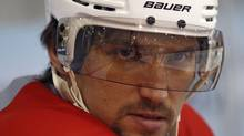 Alex Ovechkin, captain of the Washington Capitals, watches his team practice in Arlington, Virginia, April 27, 2012. The Capitals defeated the Stanley Cup champions Boston Bruins on Wednesday and will face the New York Rangers in the next round of the NHL playoffs. REUTERS/Kevin Lamarque (KEVIN LAMARQUE)