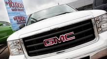 A truck is parked next to a sale sign on a GM dealership in Toronto (Darren Calabrese For The Globe and Mail)