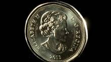 A Canadian dollar coin. (JONATHAN HAYWARD/THE CANADIAN PRESS)