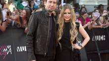 "Chad Kroeger and Avril Lavigne pose on the red carpet during the 2013 Much Music Video Awards in Toronto on June 16, 2013. Avril Lavigne and Chad Kroeger married Monday at the medieval Chateau de la Napoule outside Cannes, France - a location chosen in part because the bride was ""obsessed with castles,"" reveals an interview with Hello! Canada.The magazine is promising an exclusive interview with the Canadian rockers as well as 14 pages of photographs from their wedding in this week's issue. (Nathan Denette/THE CANADIAN PRESS)"