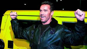 Arnold Schwarzenegger poses by his yellow Hummer as he arrives at a movie premiere in Los Angeles in 2000. Lucy Nicholson/AFP Photo