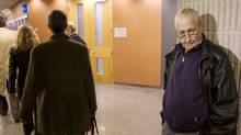 Lung-cancer victim Jean-Yves Blais (R) waits for the start of his class-action lawsuit against Canada's three main tobacco companies in Montreal, March 12, 2012. (CHRISTINNE MUSCHI/REUTERS/CHRISTINNE MUSCHI/REUTERS)