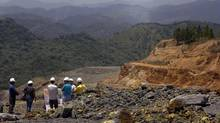 Engineers and technicians inspect Barrick's Pueblo Viejo mining project in the Dominican Republic. (Ramon Espinosa/AP)