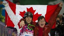 Alex Bilodeau celebrates with his brother, Frédéric, after winning a gold medal in the men's freestyle moguls event at the Sochi Winter Olympics Feb. 10, 2014. (John Lehmann/The Globe and Mail)