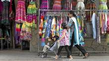 Pedestrians walk past a garment shop on Gerrard Street in Toronto's Little India Wednesday, June 8, 2011. (Darren Calabrese for The Globe and Mail/Darren Calabrese for The Globe and Mail)