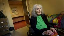 Marjorie Sheard, 95, holds a copy of J.D. Salinger's Catcher in the Rye in her room at a nursing home in Toronto on Friday. (Kevin Van Paassen/The Globe and Mail)