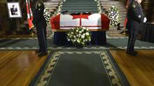 Honour guards stand by the casket of former Ontario lieutenant governor Lincoln Alexander as he lies in state at the Ontario Legislature at Queen's Park in Toronto on Sunday, Oct. 21, 2012. (Nathan Denette/THE CANADIAN PRESS)