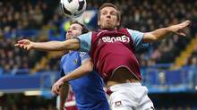 Juan Mata (L) of Chelsea and Gary O'Neil of West Ham jump for the ball during their English Premier League soccer match at Stamford Bridge in London, March 17, 2013. (ANDREW WINNING/REUTERS)