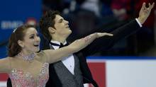 Vanessa Crone, of Aurora, Ont., and Paul Poirier, of Toronto, skate to their first place finish during the Senior Dance Short-Dance category at the BMO Skate Canada Nationals being held in Victoria, B.C. Friday, Jan 21, 2011. (Jonathan Hayward/THE CANADIAN PRESS)