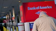 A Bank of America customer uses an ATM machine at a branch in Greenville, S.C. (CHRIS KEANE/CHRIS KEANE/REUTERS)