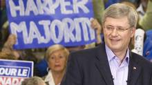 Prime Minister Stephen Harper smiles as he is applauded during a campaign speech at a rally in London, Ont., Sunday May 1, 2011. (Adrian Wyld/ The Canadian Press/Adrian Wyld/ The Canadian Press)