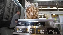 A Beer Store location in Oakville, Ont., shows the new branding and updated store style, with a walk in beer fridge, exposed wood and other new shopper-friendly features. (Deborah Baic/The Globe and Mail)