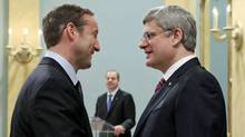 Peter MacKay shakes hands with Prime Minister Stephen Harper after being sworn in again as Minister of Defence at Rideau Hall on May 18, 2011. (CHRIS WATTIE/REUTERS)
