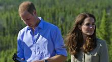 Britain's Prince William checks the sharpness of a Canadian Ranger knife while with his wife Catherine, Duchess of Cambridge, at Blatchford Lake, Northwest Territories July 5, 2011. (ANDY CLARK/REUTERS)