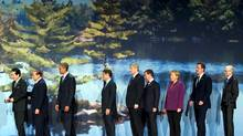 From left, Japan's Prime Minister Naoto Kan, Italy's Prime Minister Silvio Berlusconi, President Barack Obama, French President Nicolas Sarkozy, Canadian Prime Minister Stephen Harper, Russian President Dmitry Medvedev, German Chancellor Angela Merkel, British Prime Minister David Cameron and President of the European Council, Herman Van Rompuy leave following a 2010 G8 Summit photo ,with the My Summit 2010 Youth at the Deerhurst Resort in Huntsville. (SAUL LOEB/Saul Loeb/AP)