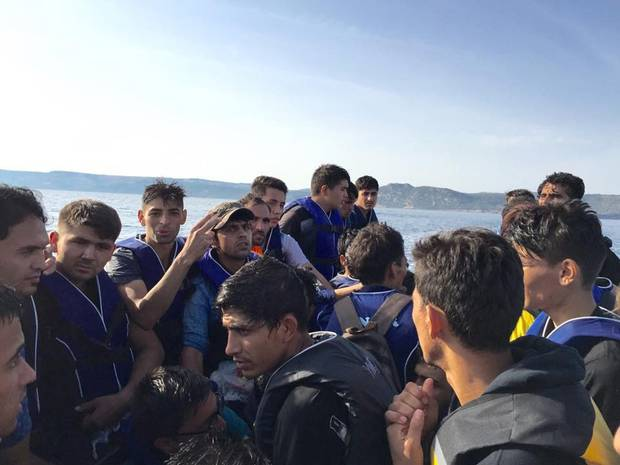 A photo taken by Mikahil Akbary, a 21-year-old law graduate from Afghanistan, shows his dinghy trip with 47 others to the Greek island of Lesbos. His relatives in Canada say it's 'impossible' to bring Mikahil and his sister in under current asylum rules.