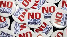 """No Casino Toronto"" buttons were handed out by Maureen Lynett, Sheila Lynett, and Peggy Calvert, who are opposed to a casino, during a casino consultation and discussion event at Toronto City Hall on Wed., January 9, 2013. (Matthew Sherwood For The Globe and Mail)"