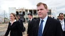 Foreign Affairs Minister John Baird and Canadian Ambassador to Libya Sandra McCardell visit the former compound of Colonel Moammar Gadhafi in Tripoli on Oct. 11, 2011. (Sean Kilpatrick/Sean Kilpatrick/THE CANADIAN PRESS)