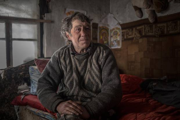 Anatoliy Ksenofontov, who lives in a shack amid the Sartana cemetery he works in, saw several gravestones damaged by rockets.