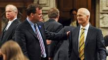 Foreign Affairs Minister John Baird and Opposition Leader Jack Layton share a moment in the House of Commons as it resumes on June 2, 2011. (Sean Kilpatrick/The Canadian Press/Sean Kilpatrick/The Canadian Press)