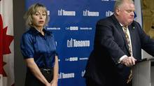 Toronto Mayor Rob Ford, accompanied by his wife Renata, makes a statement at a press conference at City Hall Nov 14, 2013. (Moe Doiron/The Globe and Mail)