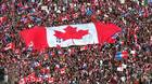 In this Friday, Oct. 27, 1995 file picture, a large Canadian flag is passed through a crowd in as thousands streamed into Montreal from all over Canada to join Quebecers rallying for national unity three days be