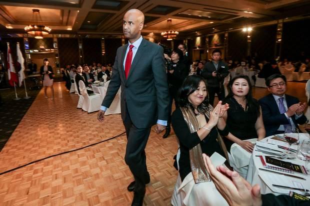 Mr. Hussen walks to the podium to speak at the gala.