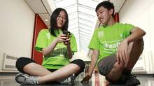 Ainslee Chen and Harvey Zhang try out the medical science apps they developed during a week-long summer camp at the University of British Columbia. (Jeff Vinnick/The Globe and Mail/Jeff Vinnick/The Globe and Mail)
