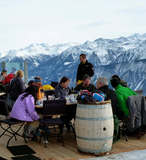 The terrace at Cabane des violettes, below, has spectacular views.