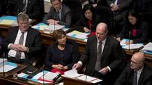 B.C. Christy Clark looks on as Finance Minister Michael de Jong delivers his budget in Victoria. (Jonathan Hayward/THE CANADIAN PRESS)