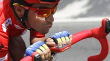 "Team Saxo Bank rider and leader of the race Alberto Contador of Spain cycles during the 21st stage of the Tour of Spain ""La Vuelta"" cycling race between Cercedilla and Madrid, September 9, 2012. (MIGUEL VIDAL/REUTERS)"