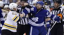 Toronto Maple Leafs' Phil Kessel (R) battles with Boston Bruins' Brad Marchand during the third period in Game 3 of their NHL Eastern Conference quarter-final hockey playoff series in Toronto, May 6, 2013. (Mark Blinch/REUTERS)