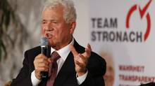 Frank Stronach answers questions during a news conference in Vienna Sept. 27, 2012. (LEONHARD FOEGER/REUTERS)