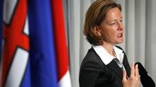 Newly-elected Alberta PC Leader and premier-designate Alison Redford holds a news conference in Edmonton on Oct. 2, 2011. (Jeff McIntosh/THE CANADIAN PRESS)