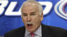 Chicago Blackhawks head coach Joel Quenneville is not impressed by a recent bobblehead likeness of himself. (AP Photo/Nam Y. Huh) (Nam Y. Huh/AP)