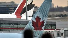 An Emirates Air jet sits at the terminal beside an Air Canada plane at Pearson airport in Toronto on Nov. 19, 2010. (J.P. MOCZULSKI/J.P. Moczulski for The Globe and Mail)