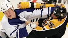 Boston Bruins Colton Orr (R) fights with Toronto Maple Leafs Wade Belak during first period play in their NHL game in Boston, Massachusetts October 27, 2005. REUTERS/Jessica Rinaldi (Jessica Rinaldi/Reuters)