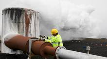 In this July 28, 2011 photo Bergur Sigfusson, the CarbFix experiment's technical manager, checks a valve at a test well at Reykjavik Energy's Hellisheidi geothermal power plant in Iceland. CarbFix's scientists will separate carbon dioxide from the volcanic field's steam and pump it underground to react with porous basalt rock, forming limestone, to see how well the gas most responsible for global warming can be locked away in harmless form. (Brennan Linsley/AP Photo/Brennan Linsley)