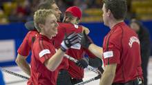 Team John Morris of Kelowana celebrates after defeating team Brad Jacobs of Sault Ste.Marie on Saturday Nov. 9, 2013 in Kitchener, Ont. (HO/THE CANADIAN PRESS)
