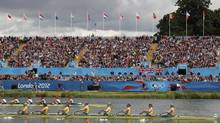 Team Australia rows alongside Team Britain in the women's eight heat at Eton Dorney during the London 2012 Olympic Games July 29, 2012. (DARREN WHITESIDE/REUTERS)