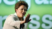 Brazil's Dilma Rousseff waves to supporters during her victory speech in Brasilia. (BRUNO DOMINGOS/Bruno Domingos/Reuters)