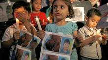 Syrian children carry pictures of 13-year-old Hamza al-Khatib and hold candles during a protest in front of the United Nations building in Beirut June 1, 2011. (JAMAL SAIDI/REUTERS/JAMAL SAIDI/REUTERS)