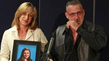 Mike and Rachael Szendrei, parents of Laura Szendrei, who was murdered in Delta, hold a photo of her during a press conference in October 2010. (Jeff Vinnick for The Globe and Mail)